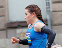 Side view of a female runner Stock Photos