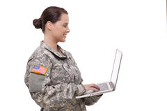 Side view of a female soldier using laptop Stock Photos