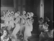 Side view of female tap dancers performing together in nightclub, 1930s stock video footage