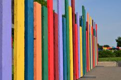 Fence made from colorful wooden planks. Side view on fence made from wooden planks painted in different vivid colors boarding children playground royalty free stock photography