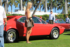 Side view Ferrari 308 GT4 and girl Stock Photos
