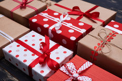 Side view of filled and wrapped present boxes Stock Photo