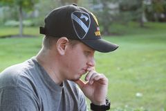Side view of First Cavalry OIF Military Veteran in thinker pose. Young Generation X Operation Iraqi Freedom Veteran Stock Photos