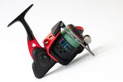 Side view of fishing reel on the white background Stock Photo