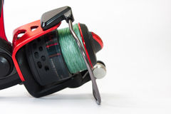 Side view of fishing reel on the white background Royalty Free Stock Photography