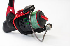 Side view of fishing reel on the white background Royalty Free Stock Images