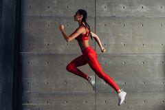 Side view fit woman doing cardio training. Side view fit woman doing cardio training stock images
