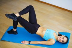 Side view of fit woman doing plank core exercise. Side view of fit woman doing plank core exercise royalty free stock photography