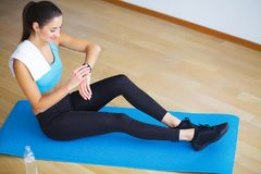Side view of fit woman doing plank core exercise. Side view of fit woman doing plank core exercise royalty free stock photo