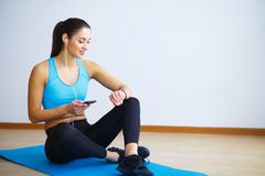 Side view of fit woman doing plank core exercise. royalty free stock photography