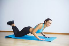Side view of fit woman doing plank core exercise stock images