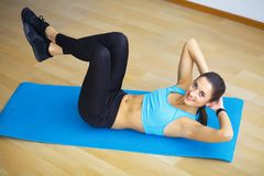 Side view of fit woman doing plank core exercise. Side view of fit woman doing plank core exercise stock photography
