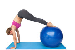 Side view of a fit woman stretching on fitness ball Royalty Free Stock Photos