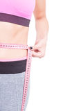 Side view of fit woman waist with tape line Royalty Free Stock Image