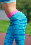 Side view of fit womans hip over park background Royalty Free Stock Photo