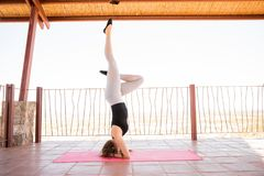 Woman doing a headstand yoga royalty free stock image