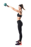 Side view of fitness gym woman doing kettlebell swing training in high position. Full body length portrait isolated on white studio background Royalty Free Stock Image