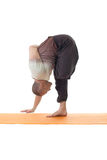 Side view of flexible man posing in yoga pose Stock Photo