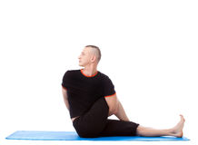 Side view of flexible man practicing yoga Royalty Free Stock Photos