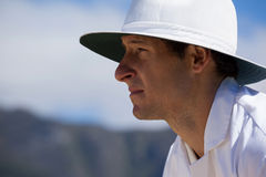 Side view of focused umpire against sky during cricket match Stock Photos