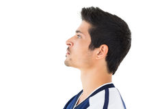 Side view of football player looking up Stock Photo