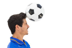 Side view of football player playing Stock Photo