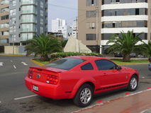 Side view of Ford Mustang 45th Anniversary Edition. Lima, Peru. March 12, 2016. Red color rear side view of a mint condition Ford Mustang GT 45th anniversary Stock Photos