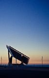 Side view of Forum at sunset. Barcelona's Forum's Solar Panels construction against sunset Stock Photo