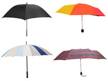 Side view of four different open umbrellas Stock Images