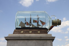 Side view of the fourth plinth at Trafalgar Square. Showing the new 'Nelson's Ship in a Bottle' installation on a sunny day Royalty Free Stock Image