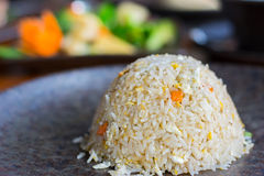 The side view of fried rice with thaifood background.  stock photos