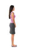 Side view full body Asian female. Side view full body of Asian female in office attire standing over white background Stock Photo