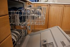 Side view full dishwasher stock image