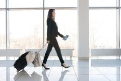 Businesswoman Walking to Gate stock photography