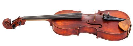 Side view of full size violin with wooden chinrest Royalty Free Stock Images