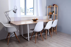 Side view of furnished conference room interior with wooden floo Royalty Free Stock Image