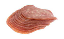 Side view of genoa salami slices on white background Royalty Free Stock Image