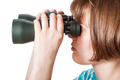 Side view of girl looks through field glasses Royalty Free Stock Images