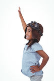 Side view of girl with outstretched arm pretending to be pilot Royalty Free Stock Image