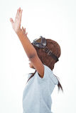 Side view of girl with outstretched arms pretending to be pilot. On white screen Stock Photos