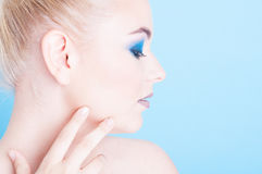 Side view of girl wearing matching nails and make-up Royalty Free Stock Images