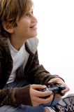 Side view of glad young kid enjoying videogame Royalty Free Stock Photography