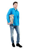 Side view of going man carries a stack of books. stock images