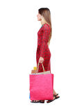 Side view of going  woman  with shopping bags . Royalty Free Stock Photography