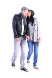 Side view of going young couple (man and woman) . walking girl a royalty free stock images