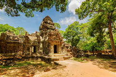 Side view of gopura at ancient Ta Som temple in Angkor, Cambodia. Side view of gopura at ancient Ta Som temple on blue sky background. Enigmatic Ta Som nestled Stock Photo