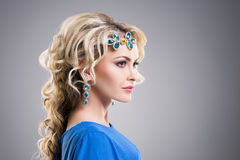 Side view of gorgeous girl wearing sapphire accessories Stock Image