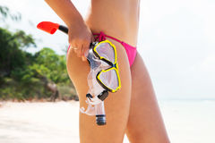 Side view of gorgeous woman with hot legs going diving with goggles Royalty Free Stock Images