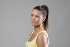 Side view of gorgeous young sporty woman with high pony tail hairstyle and natural make up Stock Photos