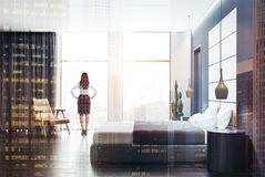 Side view of gray bedroom interior, woman stock photos